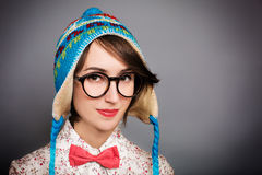 Portrait of Hipster Girl in Funny Winter Hat royalty free stock photography