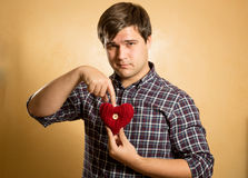 Portrait of hipster man pointing on red knitted heart Royalty Free Stock Images