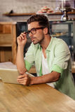 Portrait of hipster man using tablet Royalty Free Stock Photography