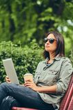 Hipster woman in a sunglasses with a coffee and tablet computer Stock Photography