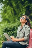 Hipster woman in a sunglasses with a coffee and tablet computer Stock Image