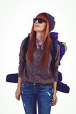 Portrait of a hipster woman with a travel bag. Against white background Stock Image