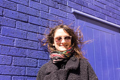 Portrait of Hipster woman with wind messing up her hair Stock Photos