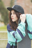 Portrait of hipster young woman with skateboard, urban lifestyle Stock Images