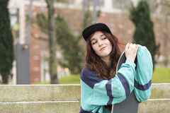 Portrait of hipster young woman with skateboard, urban lifestyle Stock Image