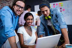 Portrait of hipsters smiling. In the office stock images