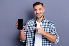 Portrait of his he nice attractive cheerful cheery confident glad bearded grey-haired guy wearing checked shirt showing royalty free stock images