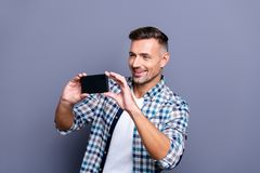 Portrait of his he nice attractive cheerful cheery content bearded grey-haired guy wearing checked shirt making photo stock photos