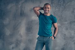 Portrait of his he nice attractive cheerful cheery strong content masculine guy wearing trendy blue t-shirt modern look. Enjoying day dream isolated over gray royalty free stock photos