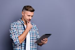 Portrait of his he nice attractive content concentrated focused bearded grey-haired guy wearing checked shirt searching stock images