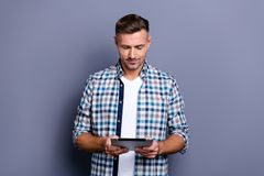 Portrait of his he nice attractive content focused bearded grey-haired guy wearing checked shirt browsing web isolated stock image