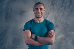 Portrait of his he nice attractive strong powerful cheerful cheery guy wearing trendy blue t-shirt modern look digital. Smart watch clock isolated over gray royalty free stock image