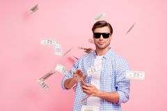 Portrait of his he nice cool trendy content attractive handsome candid guy wearing checked shirt throwing money flying royalty free stock photo