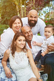 Portrait of hispanic big family. In green sunny park Royalty Free Stock Photography