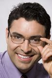 Portrait Of A Hispanic Businessman Trying Out Glasses Stock Images