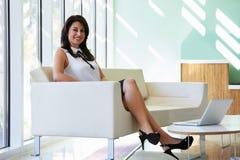 Portrait Of Hispanic Businesswoman In Modern Office Royalty Free Stock Photos