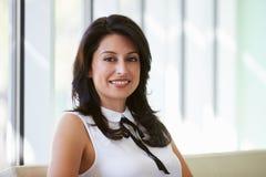 Portrait Of Hispanic Businesswoman In Modern Office Stock Photo
