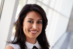 Portrait Of Hispanic Businesswoman In Modern Office Royalty Free Stock Images