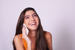 Portrait of hispanic / caucasian young woman using a mobile phon Royalty Free Stock Photos