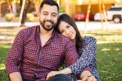 Portrait of a Hispanic couple. Attractive young Hispanic couple relaxing and cuddling at a park Stock Images