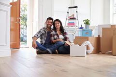 Portrait Of Hispanic Couple Moving Into New Home Royalty Free Stock Photo