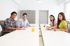 Portrait Of Hispanic Designers Meeting To Discuss New Ideas Stock Image