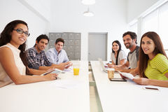 Portrait Of Hispanic Designers Meeting To Discuss New Ideas Royalty Free Stock Photography
