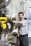 Portrait of a Hispanic employee using circular saw Royalty Free Stock Image
