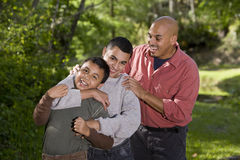 Portrait of Hispanic family with two boys outdoors Stock Images