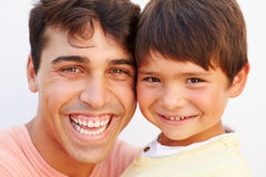Portrait Of Hispanic Father And Son Stock Photos