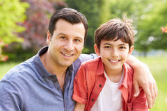 Portrait Of Hispanic Father And Son Stock Images
