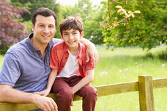 Portrait Of Hispanic Father And Son Stock Photo