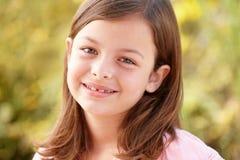 Portrait Hispanic girl outdoors. Smiling Stock Photography