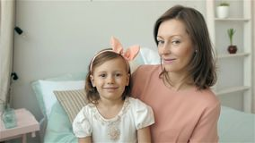 Portrait hispanic mother and daughter at home, mom and child little girl stock video