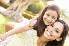 Portrait Of Hispanic Mother And Daughter In Park Stock Images