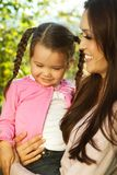 Beautiful Hispanic woman with her daughter. Portrait of a Hispanic mother and her daughter Stock Images