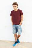 Portrait Of Hispanic Teenage Boy Leaning Against Wall Stock Images
