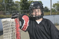 A Portrait of hockey ball player with hockey stick Stock Photos