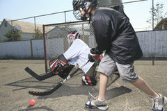Portrait of hockey ball player with hockey stick royalty free stock image