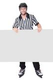 Portrait of hockey judge presenting empty banner Royalty Free Stock Photos
