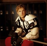 Portrait Of A Hockey Player. In a locker room Royalty Free Stock Photos