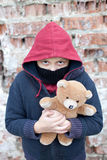 Portrait of a homeless boy with bear. The portrait of a homeless boy with bear Stock Photos