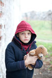 Portrait of a homeless boy with bear Stock Photo