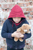 Portrait of a homeless boy with bear Stock Photography