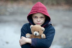 Portrait of a homeless boy with bear. The portrait of a homeless boy with bear Stock Images