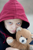 Portrait of a homeless boy with bear. The portrait of a homeless boy with bear Royalty Free Stock Image