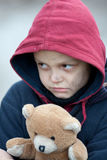 Portrait of a homeless boy with bear. The portrait of a homeless boy with bear Royalty Free Stock Photography