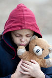 Portrait of a homeless boy with bear. Portrait of a homeless young boy with bear Royalty Free Stock Photography