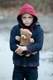 Portrait of a homeless boy with bear. Portrait of a homeless young boy with bear Royalty Free Stock Images
