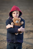 Portrait of a homeless boy with bear Royalty Free Stock Photos